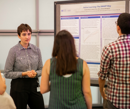 Data Science intern Caroline Kerry explains her research to visitors at the Internship Showcase.