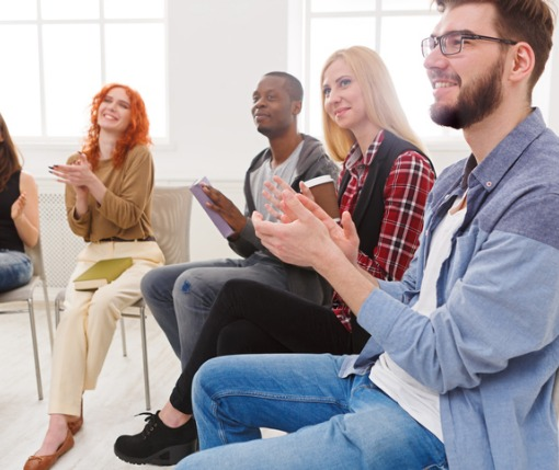 Individuals attend group therapy for addiction