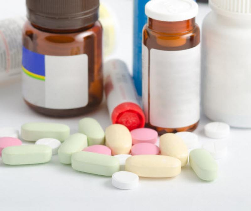 Pills in front of medicine bottles