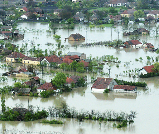 Flood waters rise among homes