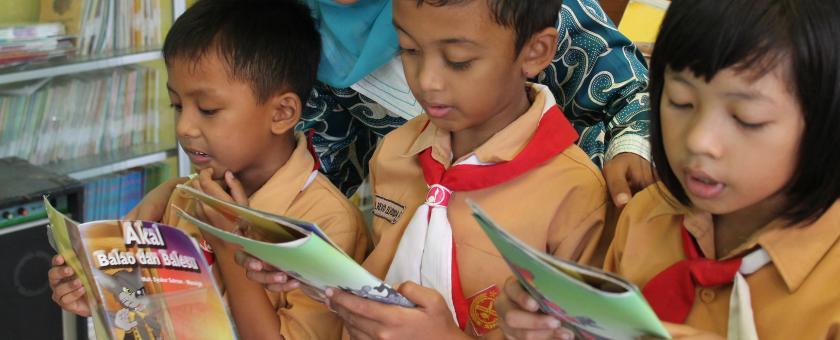 Children reading books in Indonesia