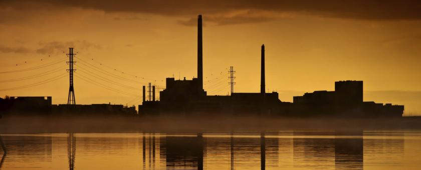 An electric power plant with a sunset background
