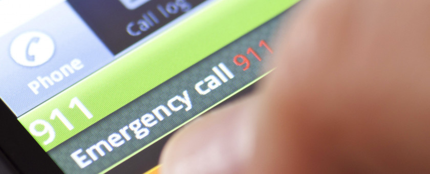 A closeup of someone dialing 911 on a smartphone