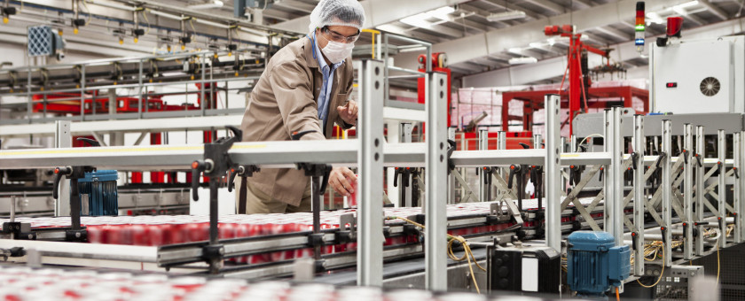 An inspector checks a food production line