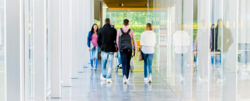 College students walking in a corridor