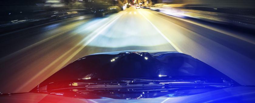 police car lights flashing at night