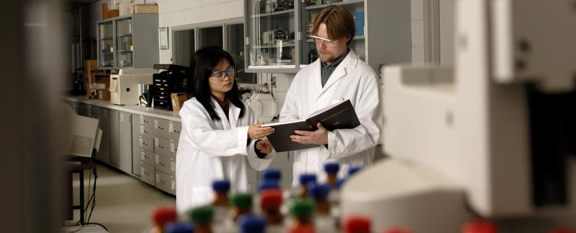 Researchers in a lab working on polymeric material