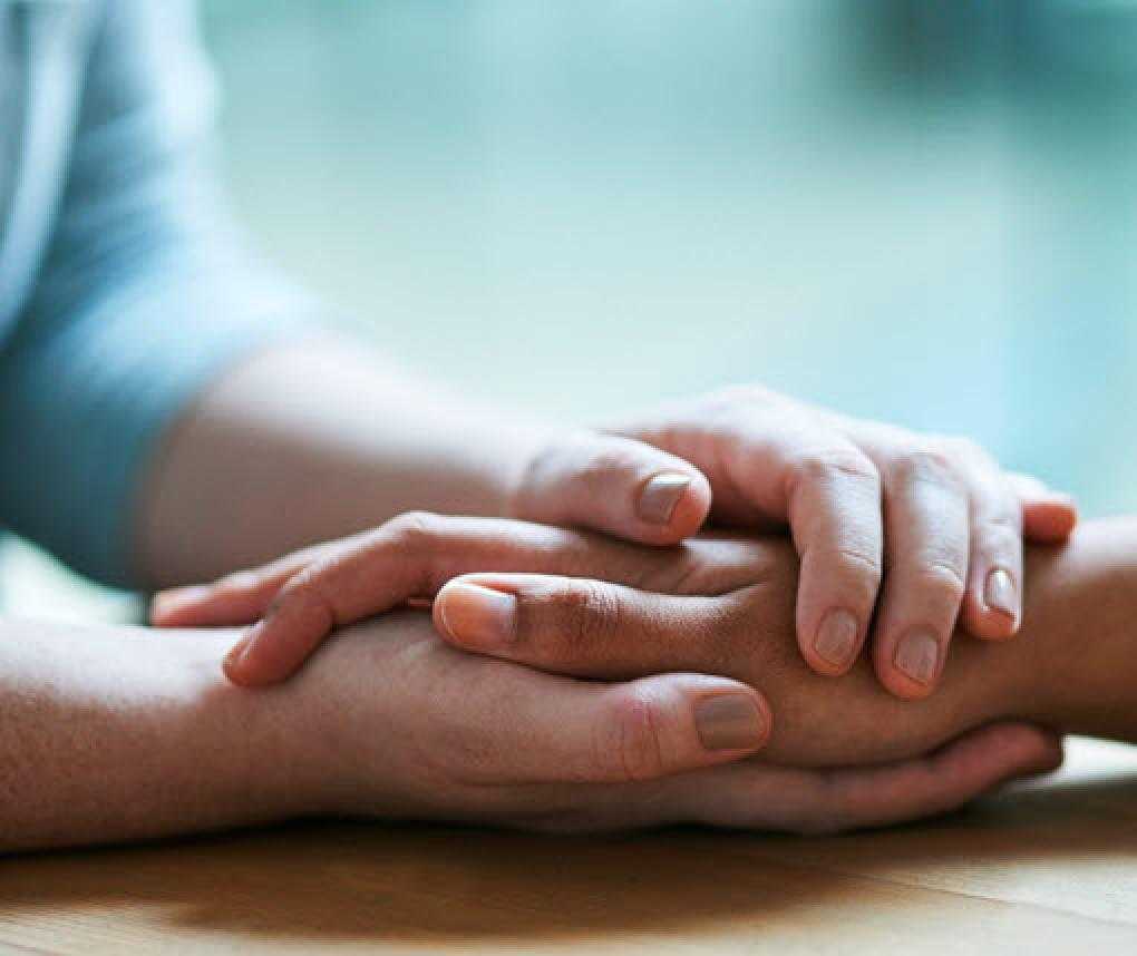 holding hands in a hospice