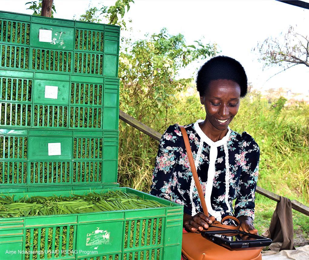 Through the USAID/Rwanda-supported internship pilot program, Antoinette Umurerwa is assisting the Abadasigana Kinyinya Cooperative with its accounting practices. Credit: Aime Ndayisenga/USAID PSDAG Program.