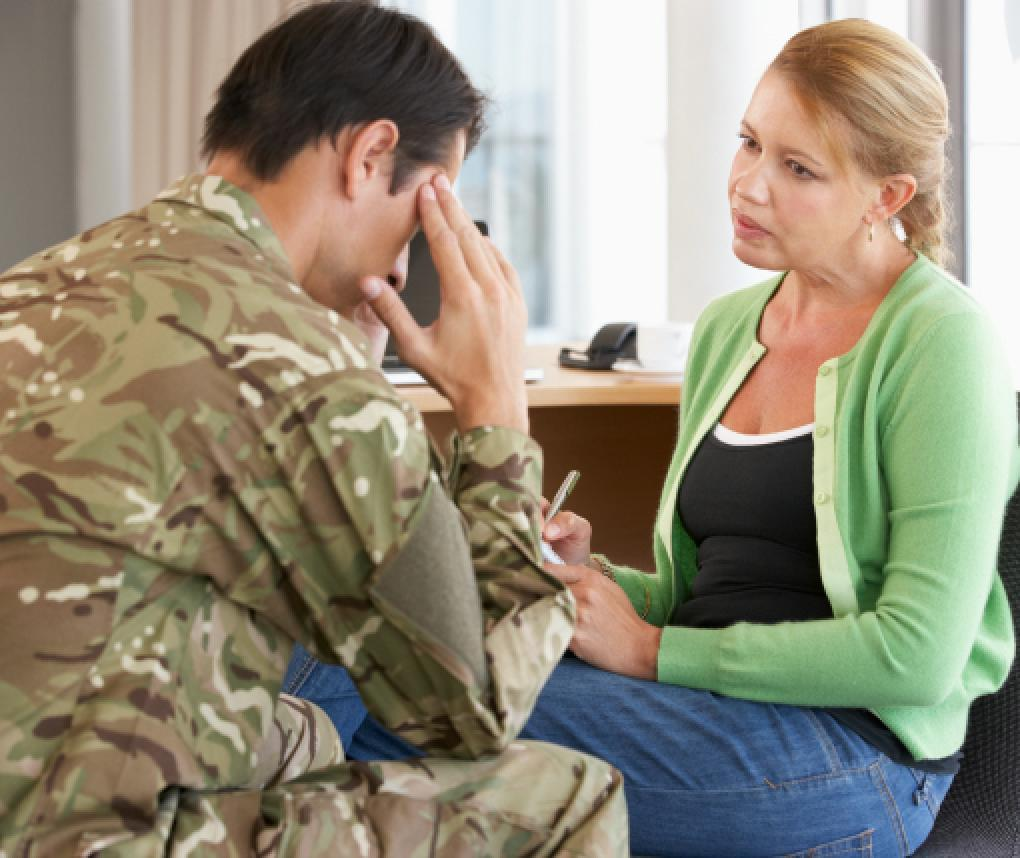 A male soldier talks to a female counselor