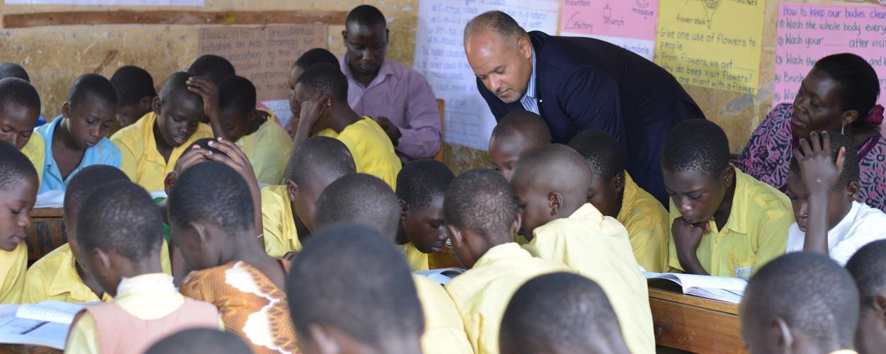 Paul Weisenfeld observes a classroom of students in Uganda