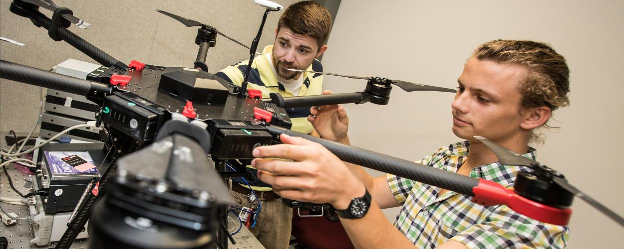 Technicians work on the Advanced Smart Sensor Technology drone.