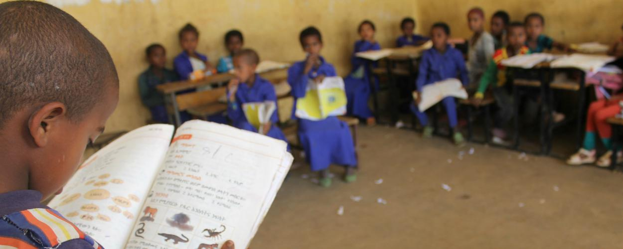 Children in an Ethiopian classroom use RTI's curriculum to learn English and mother tongue languages.