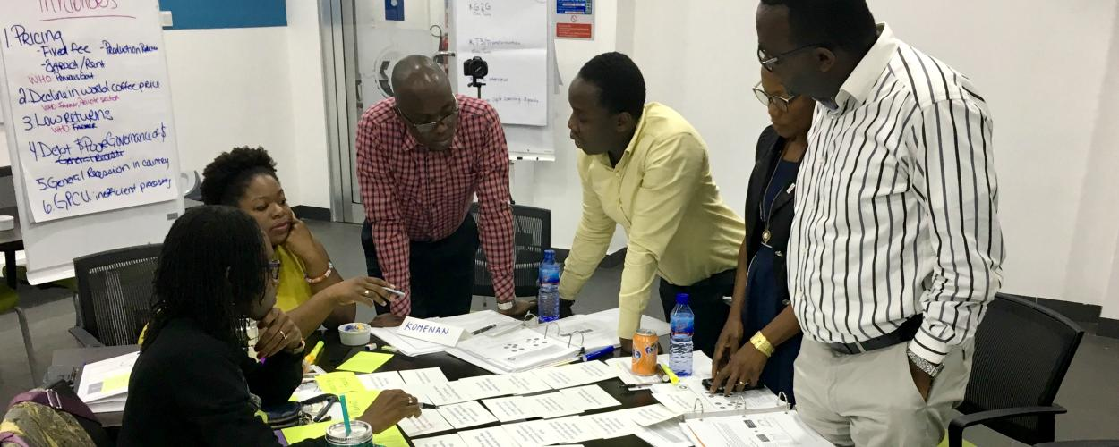 International development professionals discuss economic issues during a training session.