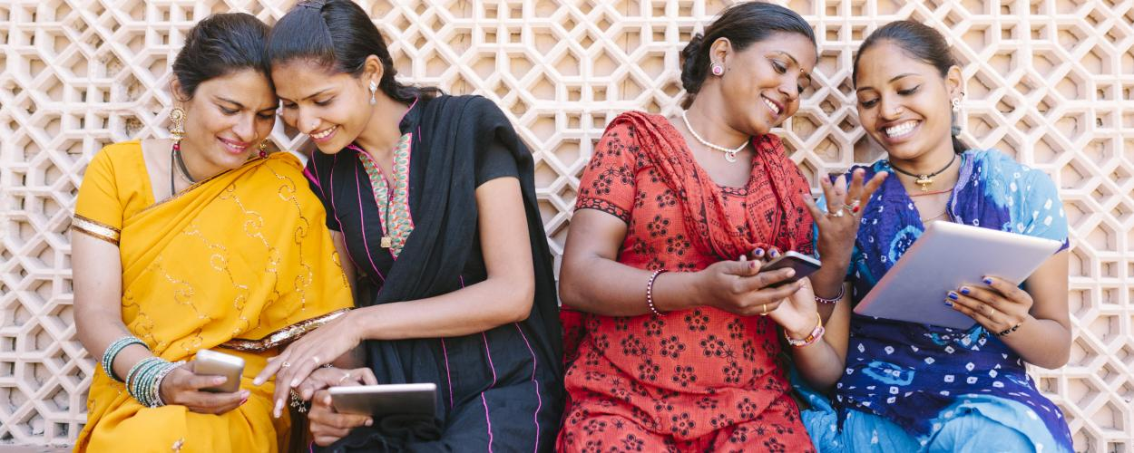 Indian women working on computers and mobile devices