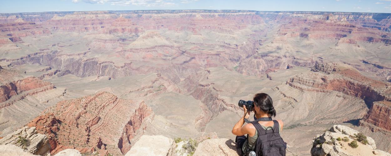 Woman looking at Grand Canyon