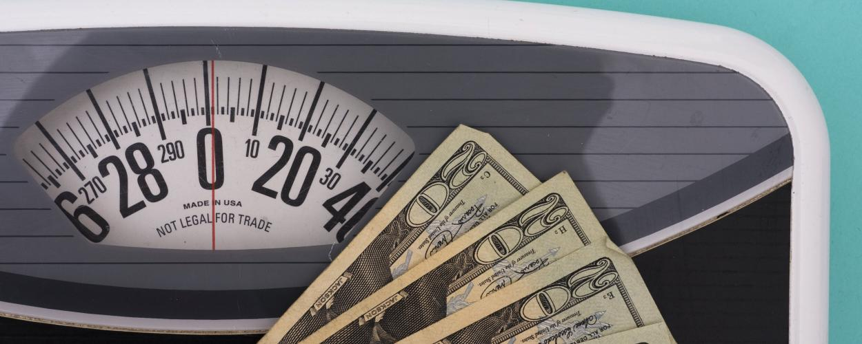 A scale for measuring weight and dollars