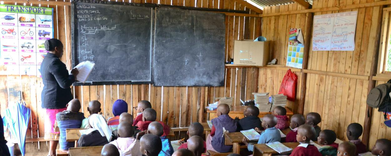 Teacher in Kenya leads a reading lesson