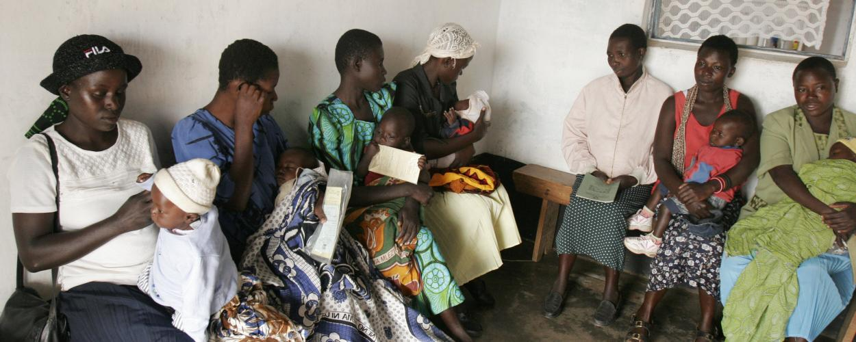 mothers and babies wait in a Kenyan health clinic