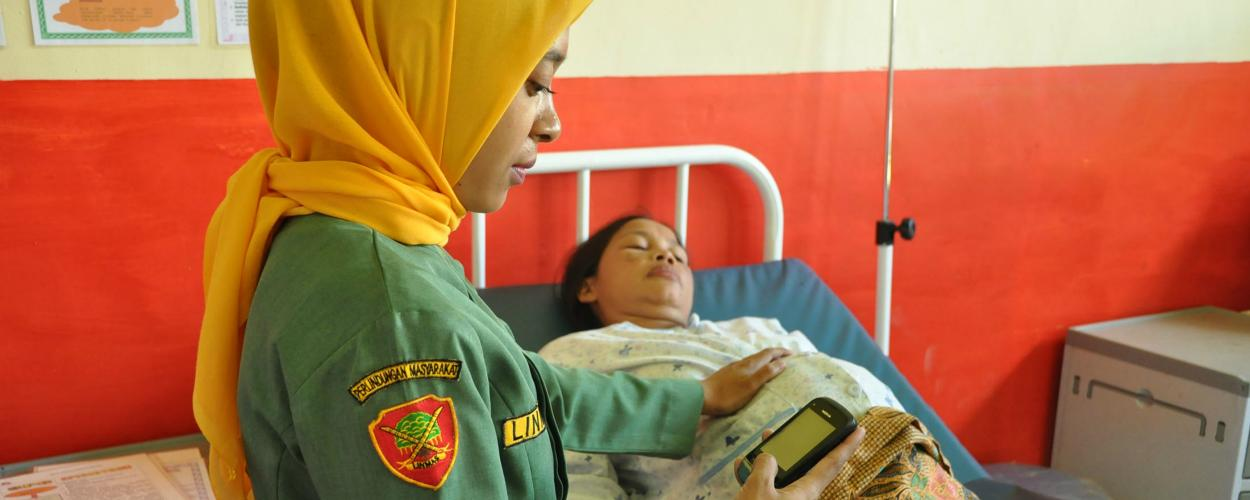 A woman gives birth in Indonesia