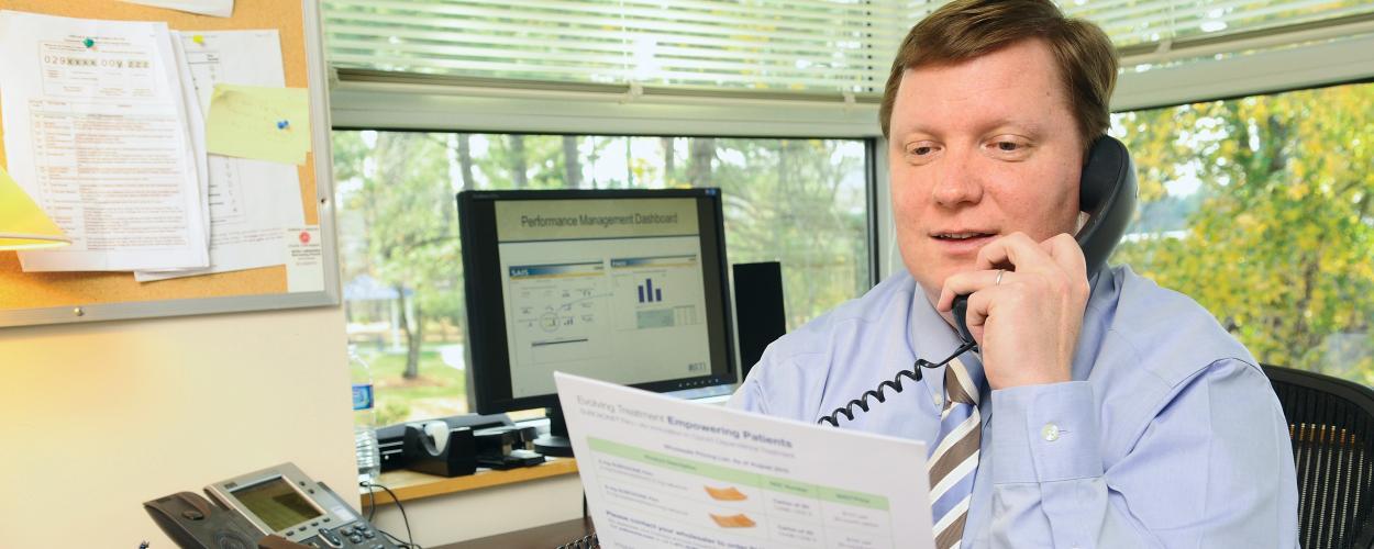 RTI researcher Scott Novak reads from a report