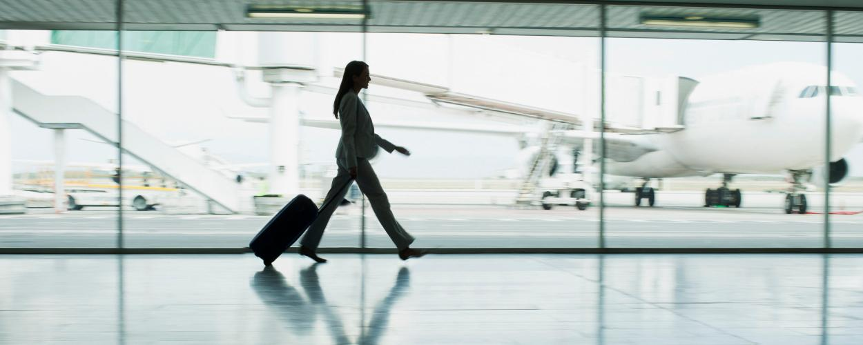 A women makes her way through the airport