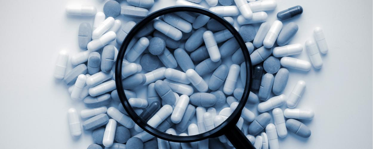 Pills Magnifying glass opioid drugs
