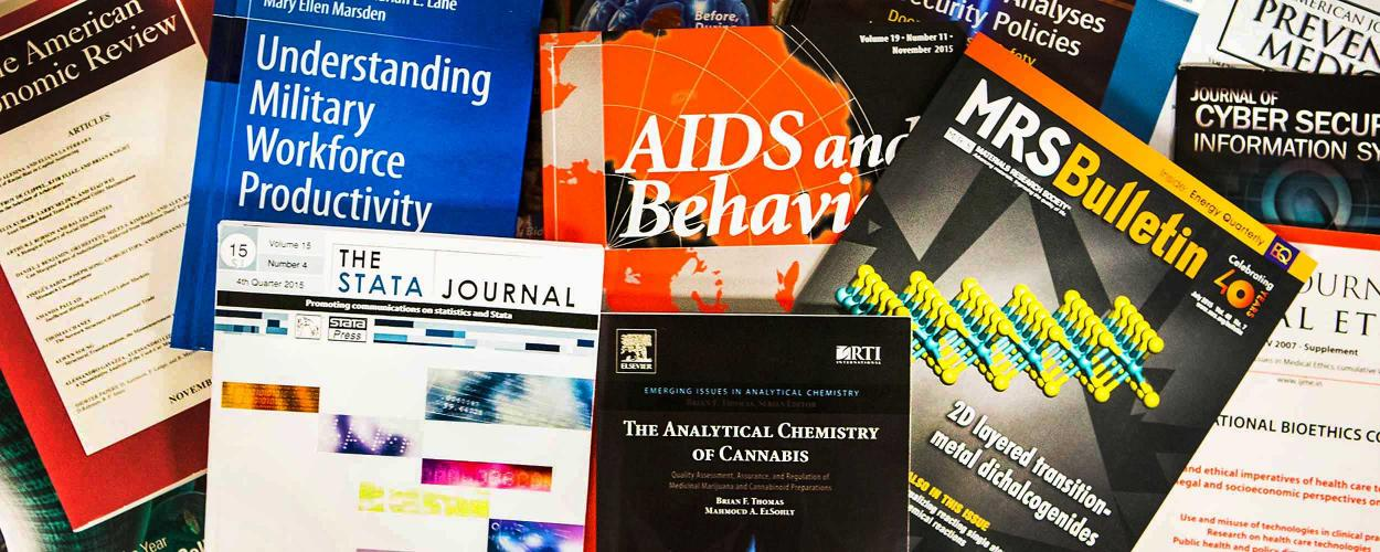 assortment of academic journals, books, and scholarly publicattions