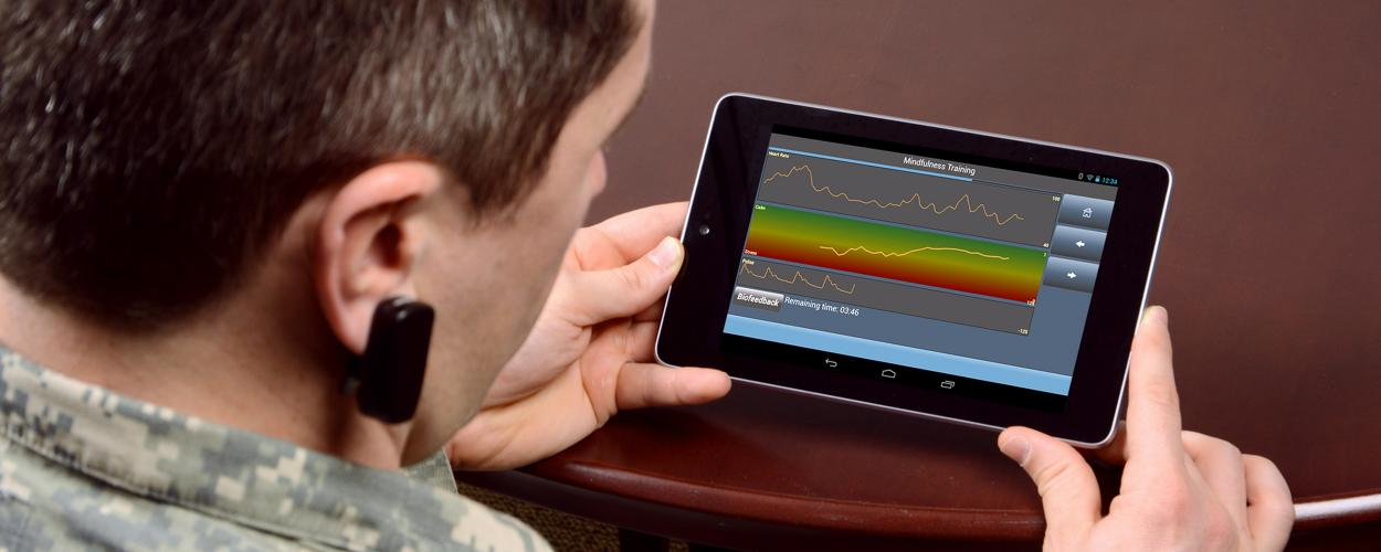 A soldier uses the PHIT application