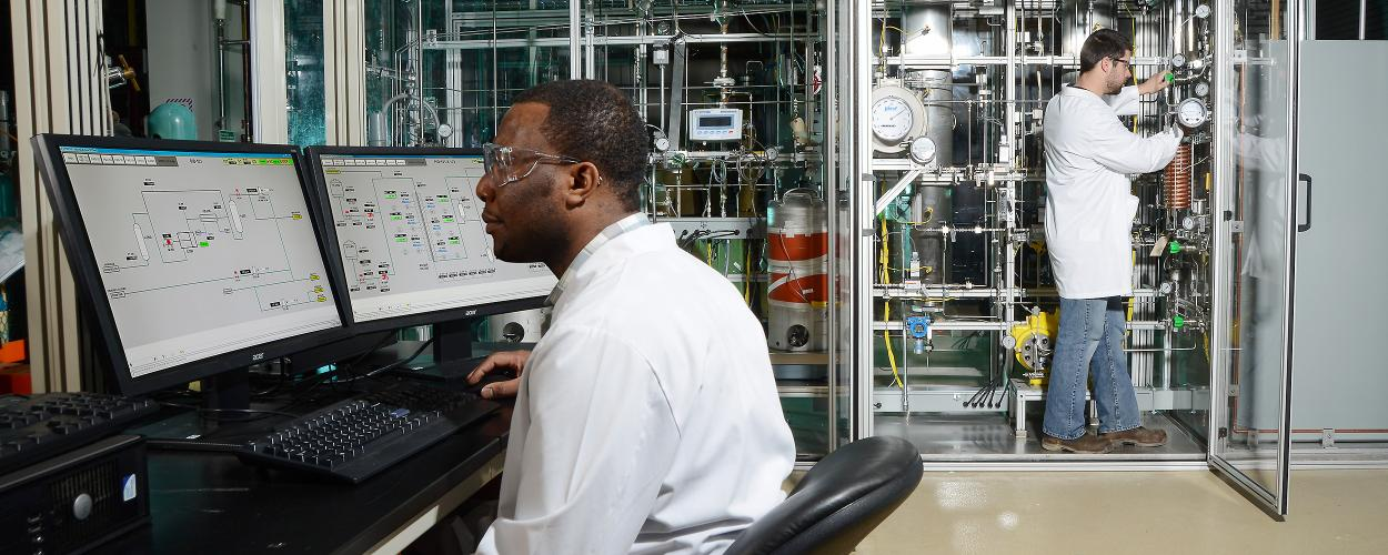 Scientist man using hydrotreater equipment
