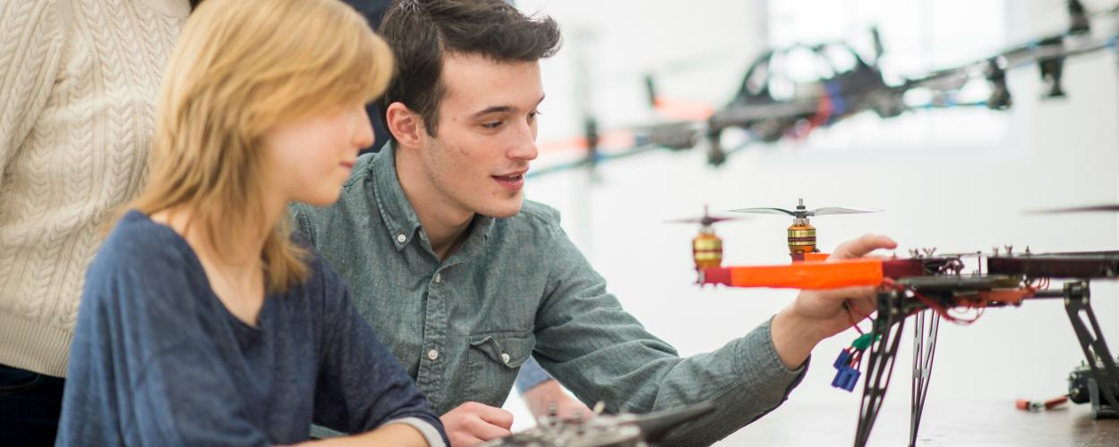 Innovators work on a drone prototype