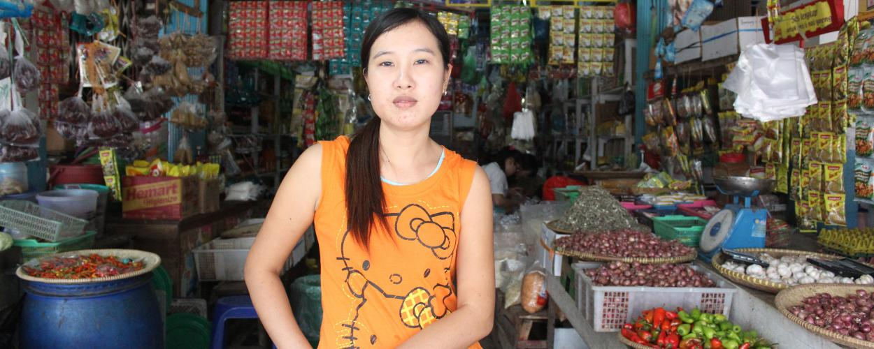 A woman shop owner in Asian market