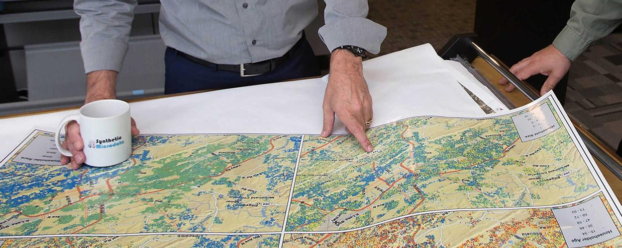 our GIS experts examine large-format maps