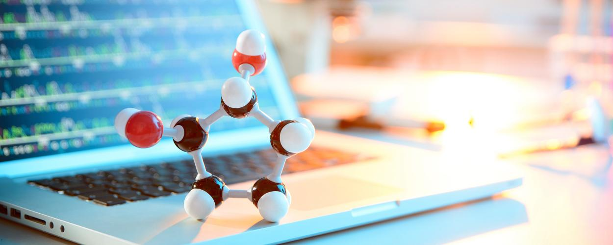 Molecule structure in front of laptop