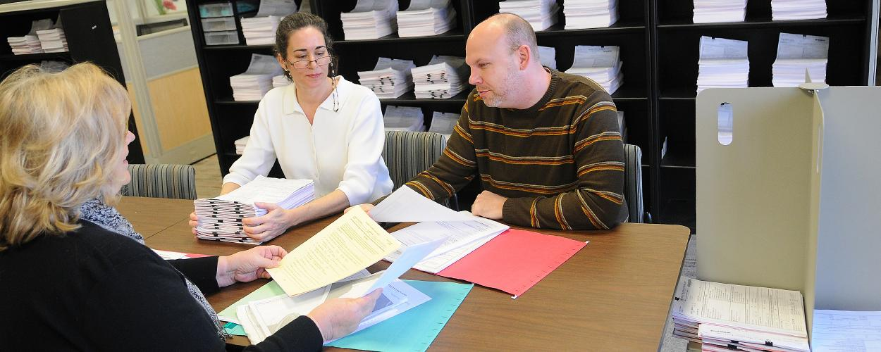 Two women and a man work together at RTI's Research Operations Center
