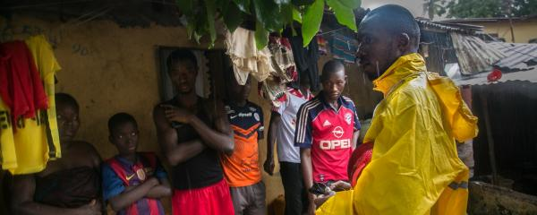 Community health worker conducts home visit in Matam Conakry, Guinea