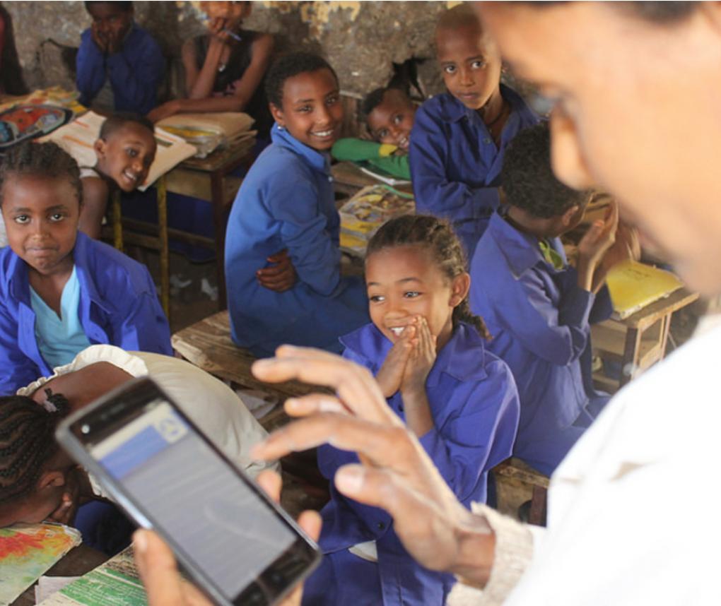 Teacher with mobile phone