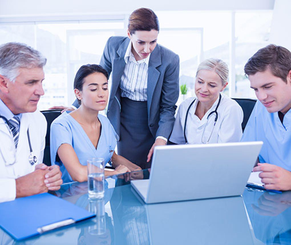 Doctors and health care administrators review data