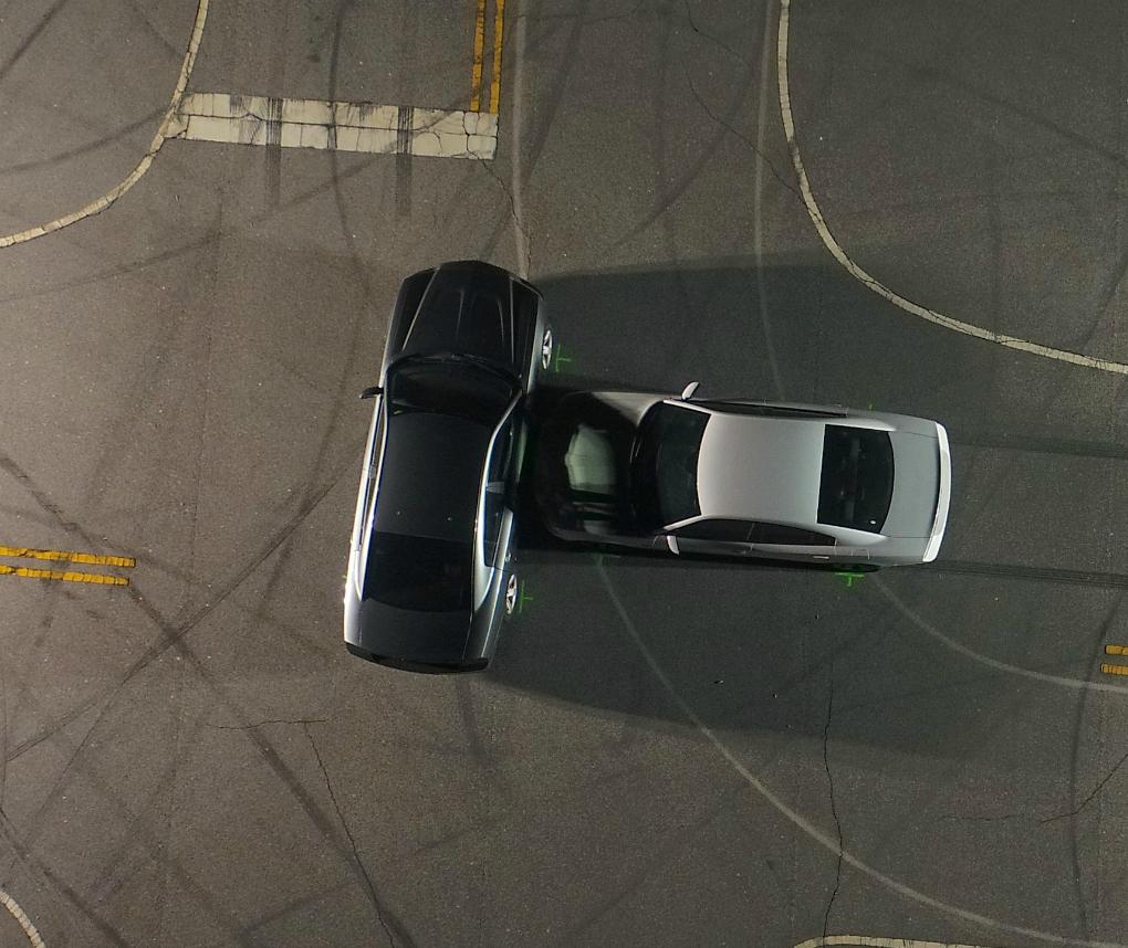 This aerial photo shows a simulated car collision scene as seen from a drone.