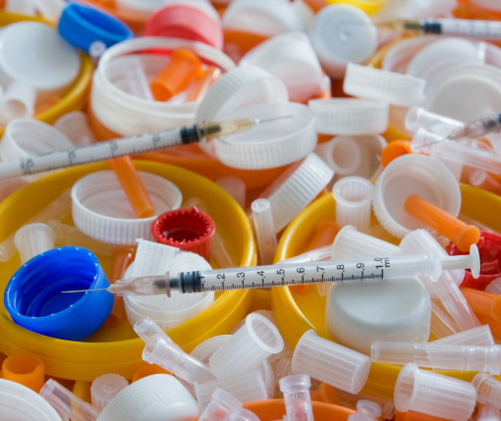 A collection of hypodermic needles and other medical supplies