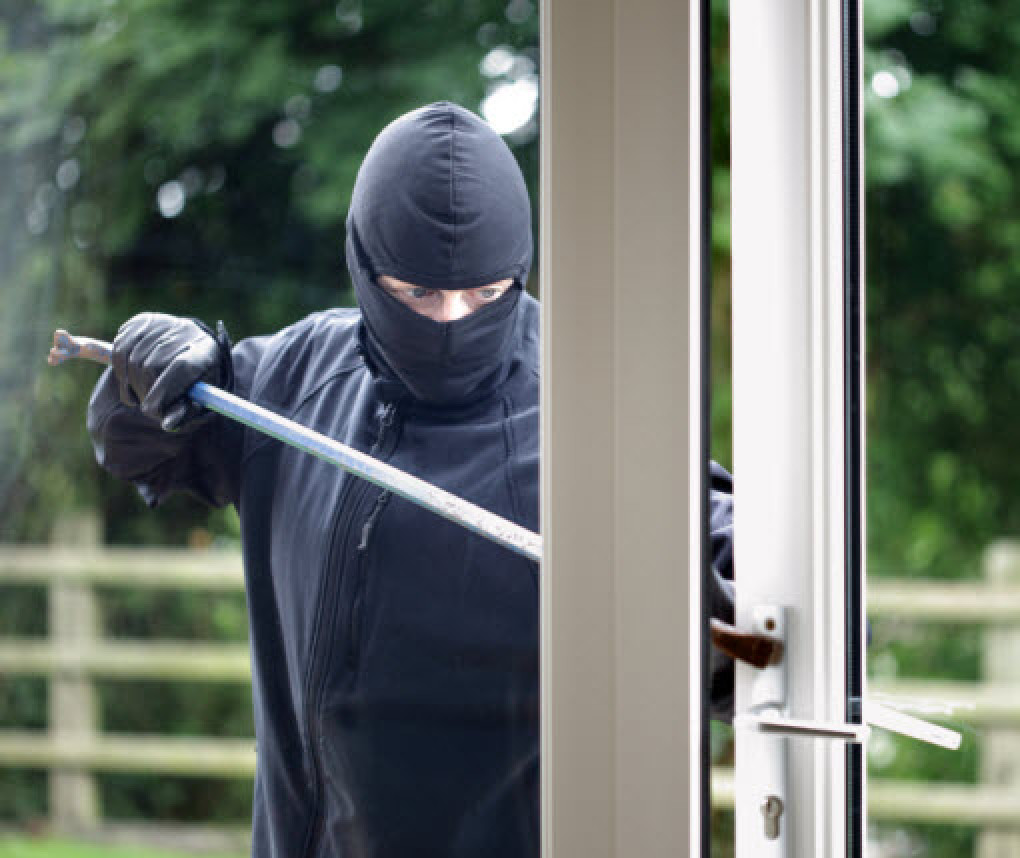 burglar breaking into a home