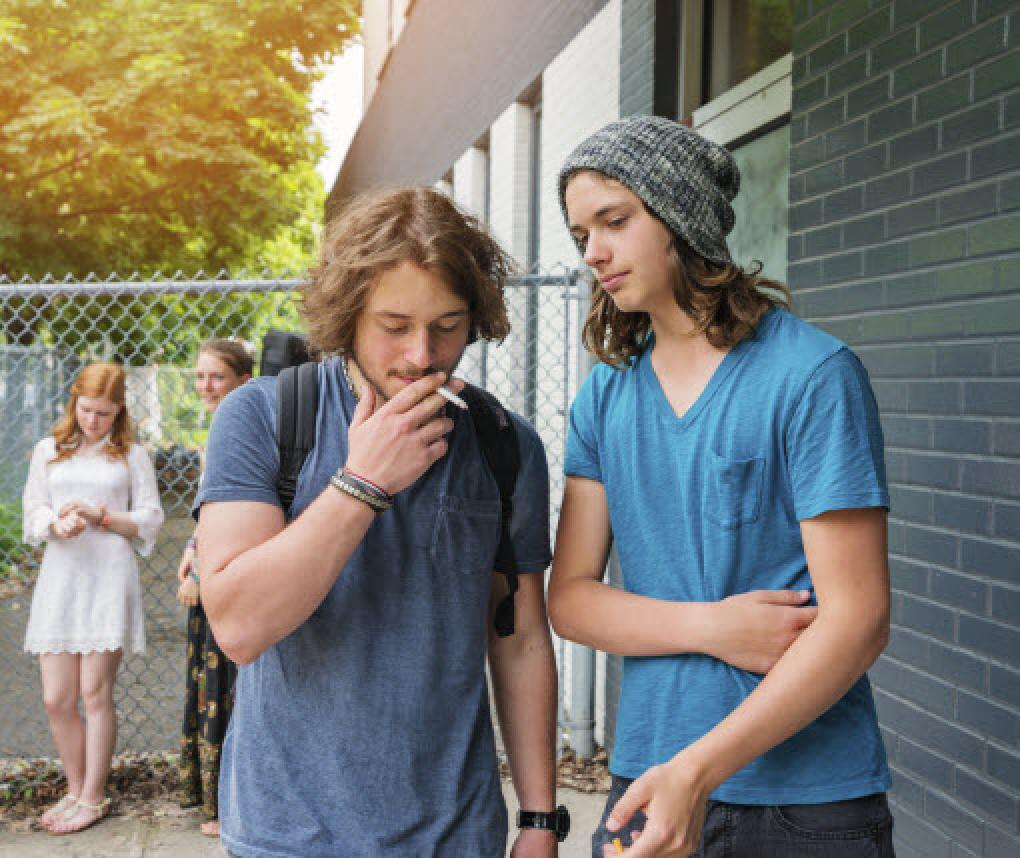 teenage boys smoking tobacco
