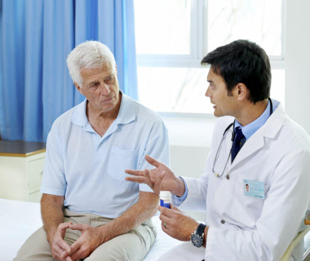 male patient with doctor in an exam room