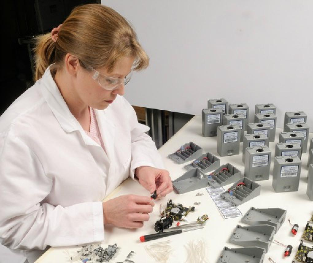 A woman works with RTI MicroPEM devices