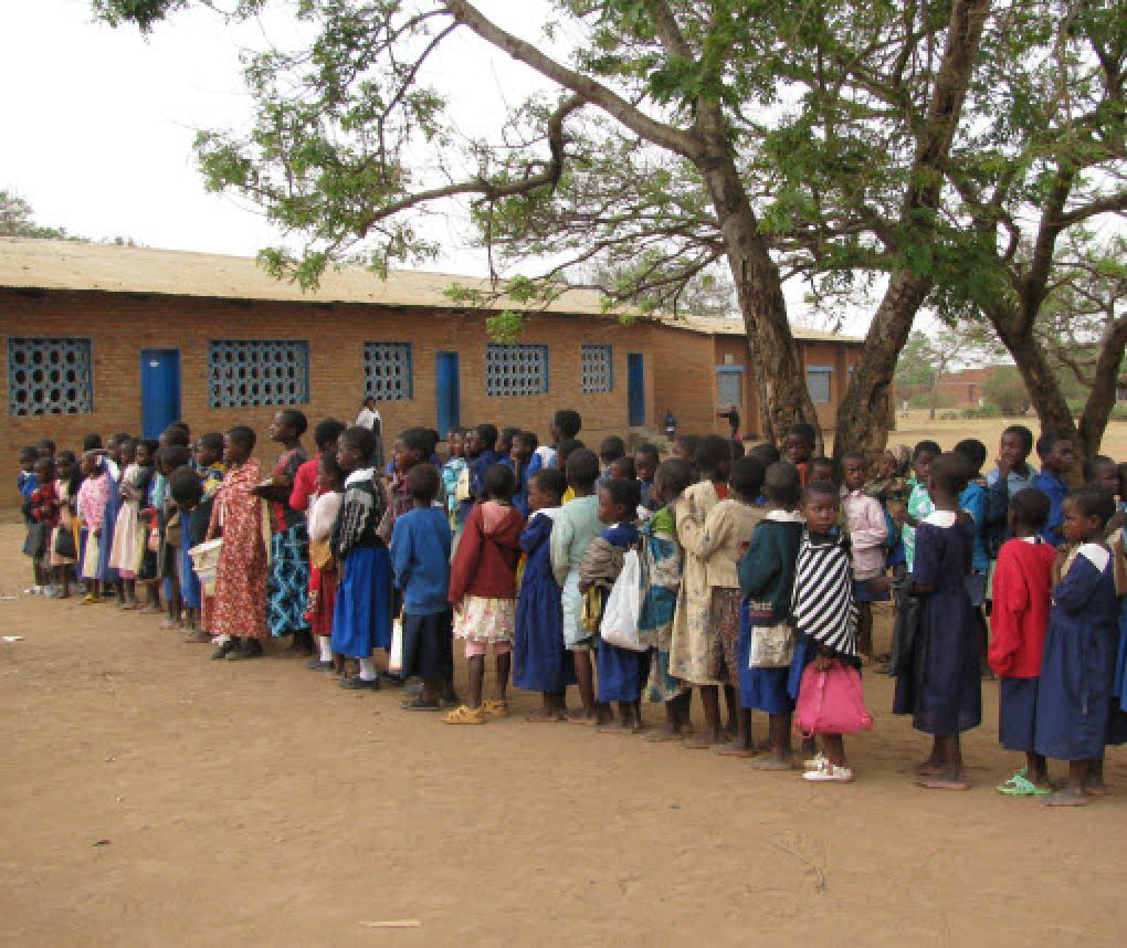 Children in Malawi line up for school