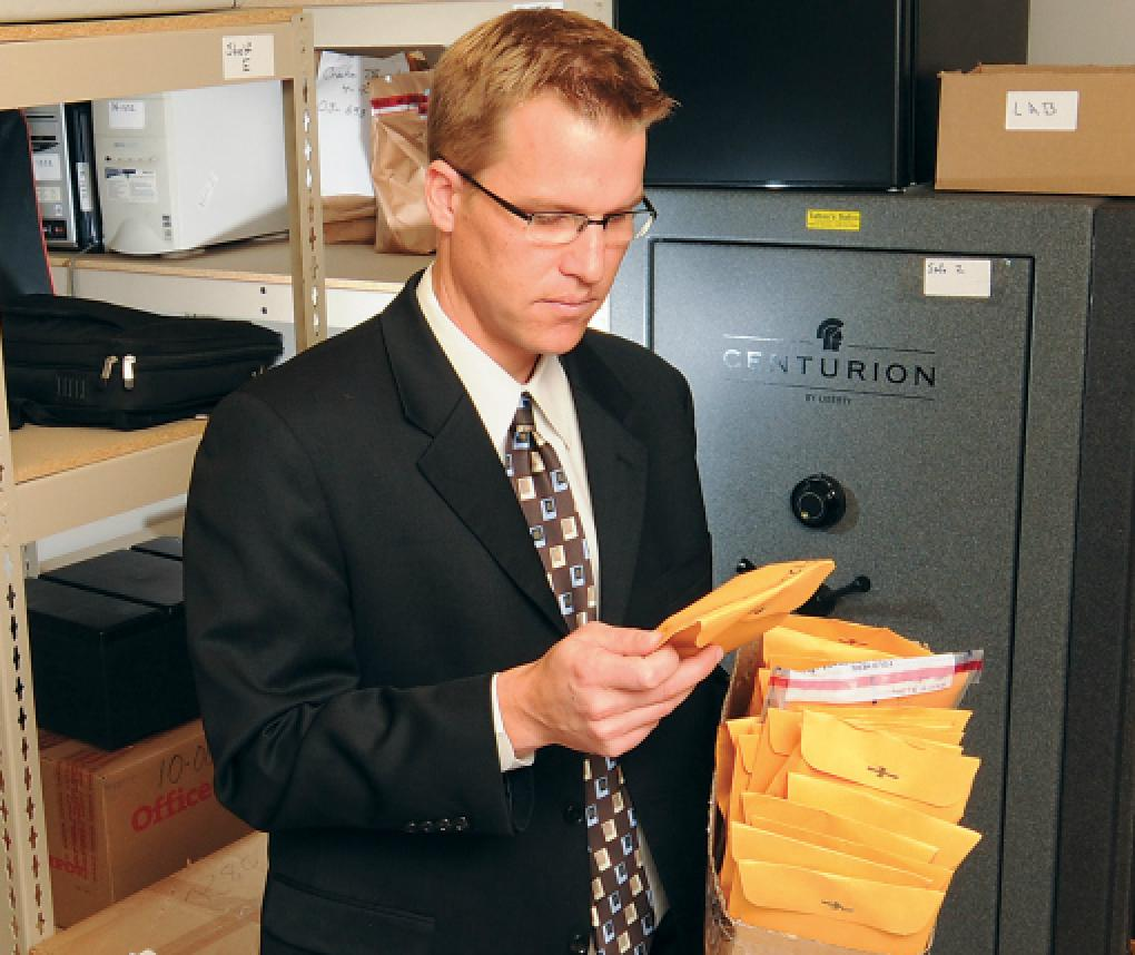 Kevin Strom examines a backlog of evidence files