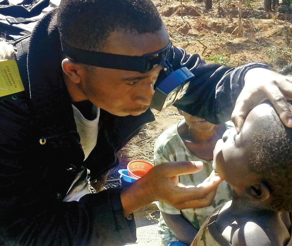 A child's eyes are examined for neglected tropical disease